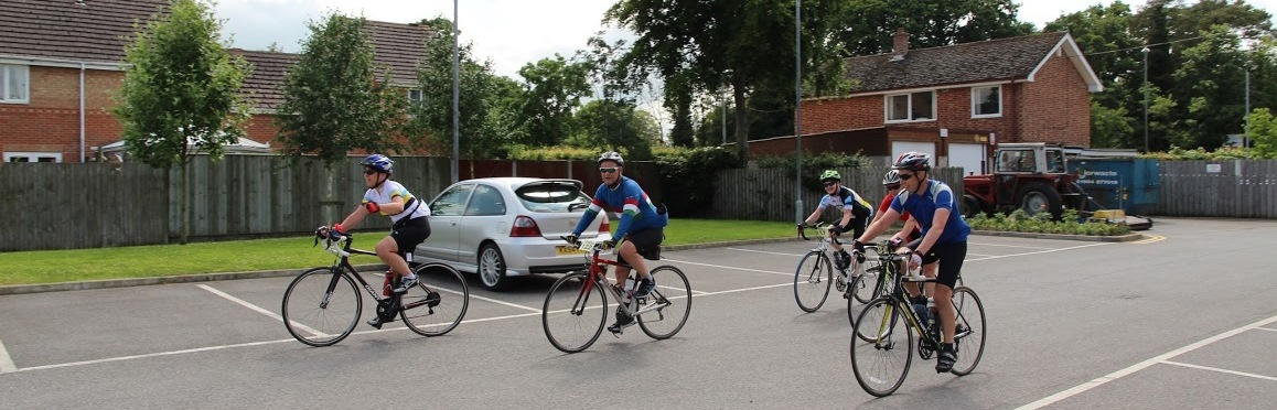 Cyclists returning to the event finish at Norton College