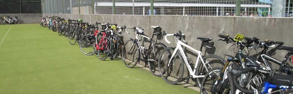 Bikes are securely parked in the tennis courts compound