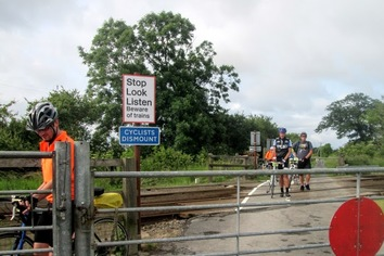Cyclists dismount to cross the railway line